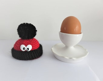"""""""Red and black hat with Pompom and eyes"""" egg covers"""