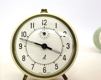 Little beige vintage alarm clock produced by Jaz.