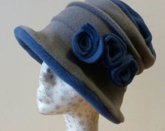 Gray and denim blue fleece hat with handmade flower detail.