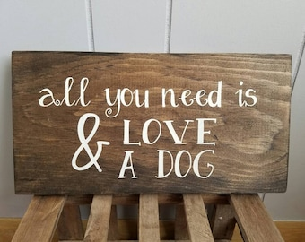 All you need is love and a dog wood wall art