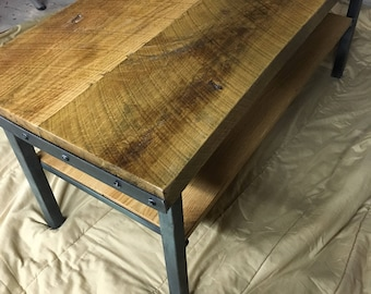 Steampunk coffee table with wood and steel.