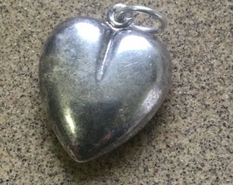 Large silver heart pendant (vintage ) in fair condition for age  worn in places from use ! On a jumpring !