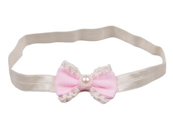 Pink vintage bow with lace and pearl on a baby headband handmade in the UK nylon skinny elastic newborn photography prop