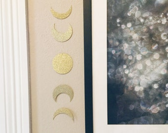 Phases of the moon wall hanging
