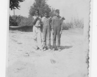 1930s  photograph of 3  African Americans students on the playground at a one room school house a reprint from original photograph