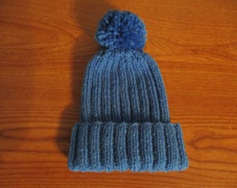 ribbed hat with pompom blue hand-knit for a child girl boy