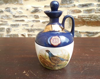 Vintage Rutherford's Scottish Whisky jug, empty.