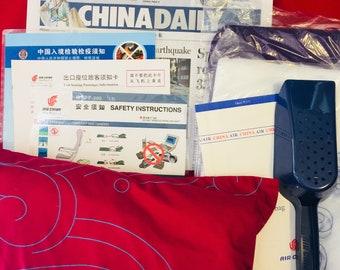 AIR CHINA B-777 passenger briefing card and amenity package