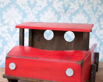 Baby boy Wooden Photographers Prop,In the style of a Truck,In red and brown,with box at the back to snugle a newborn baby Boy in.made in uk