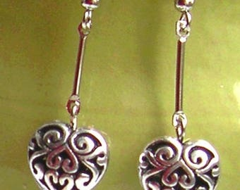 HEART EARRINGS decorated with silver metal
