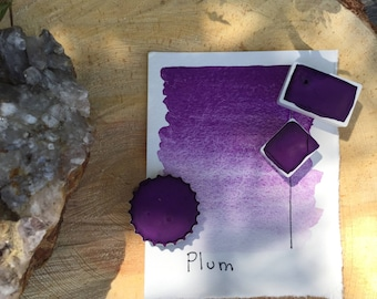 Half pan, full pan or bottle cap of handmade plum watercolor paint