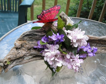 Floral arrangement Rustic driftwood arrangement with red butterfly