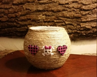 Jute Wrapped Candle Holder With Skull and Crossbone Embellishments