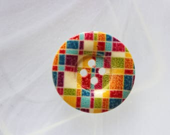 wooden button with lines and squares