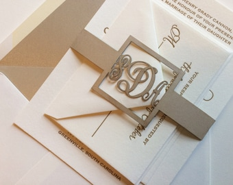 Custom letterpress and laser cut wedding invitation with nude metallic colors