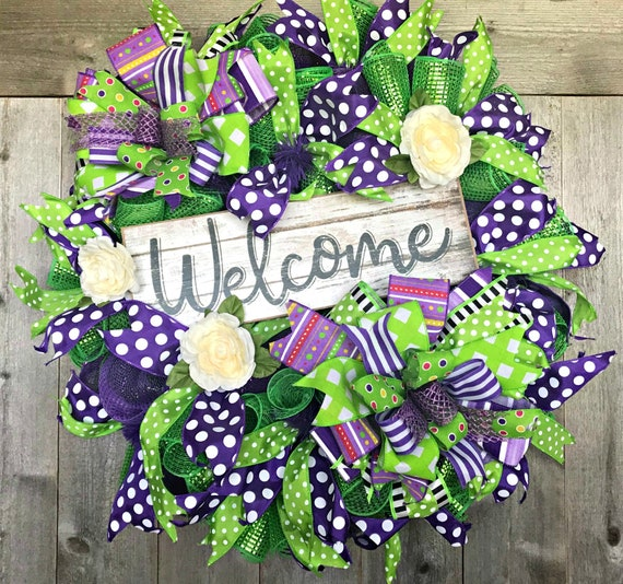 Purple and green welcome wreath
