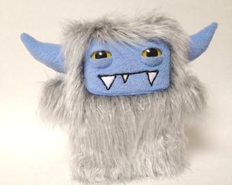 Harvey: a grey shag faux fur plush monster