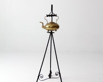 antique tea kettle with wrought iron stand