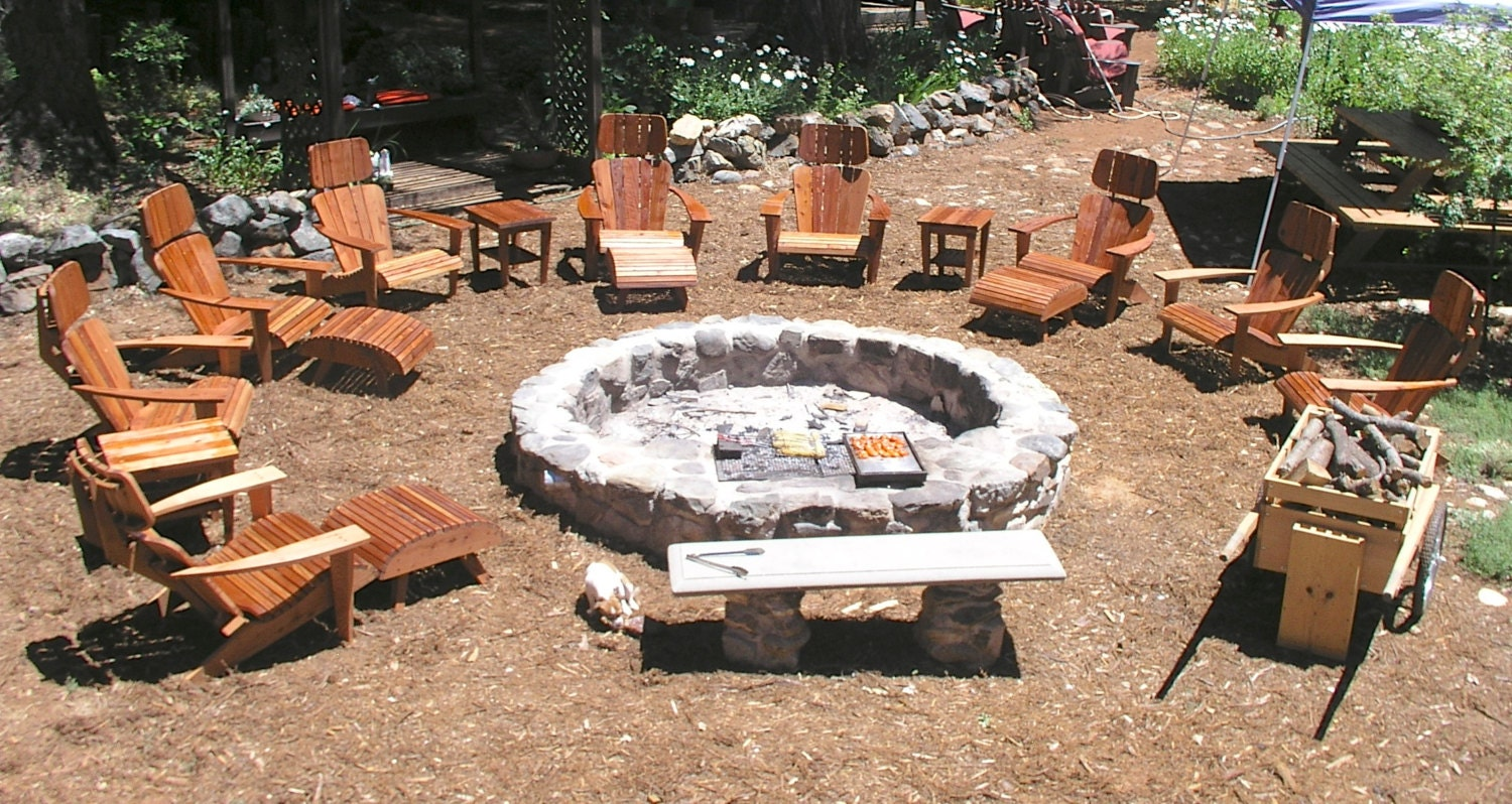 custom fire pits designed to cook on open pit cookery real. Black Bedroom Furniture Sets. Home Design Ideas