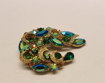 Heavily jewelled green spinx brooch