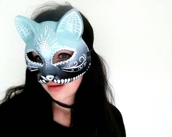 Hand painted dia de los muertos style cat mask in blues
