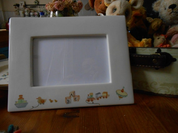 Photo frame for Baby picture cream ware china with toys as ...