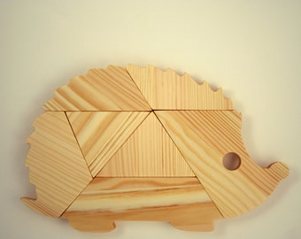 Wooden animal puzzle. hedgehog puzzle. Mind game. Brainteasers game.