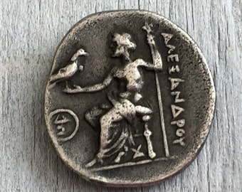 Vintage facsimile of an Ancient Alexander the Great coin, with the goddess of Athena on the reverse. Byzantine coin, Museum copy.
