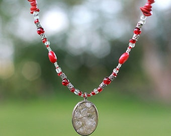 """Quartz pendant on 18"""" beaded necklace of red, clear, and silver"""