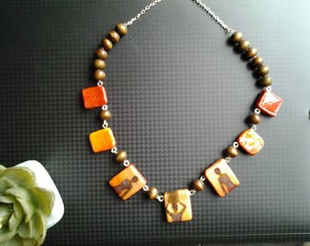 Necklace flat beaded African women silhouettes