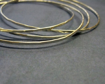 sterling silver bangles. four intertwined bangles in one