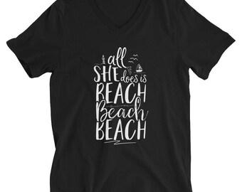 All She Does is Beach Beach Beach T-Shirt - Summer Shirt - Women's V-Neck Shirt