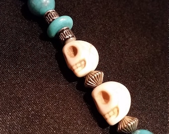Turquoise, silver, ivory skull