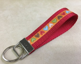 A key fob, gorgeous jacquard ribbon with webbing. Hearts on Red.