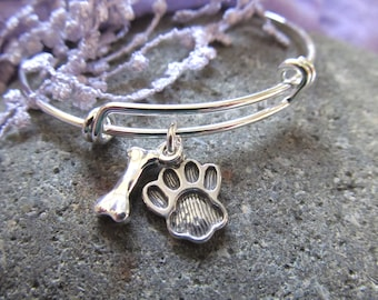 Sterling Silver Paw Print With Silver Plate Dog Bone Presented On An Over The Wrist Expandable Silver Plate Bracelet