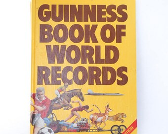 guinness book of world records   1978 edition   edition 24   vintage yellow book   history collectors book   coffee table books
