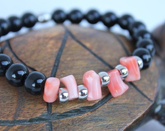 Stretch Bracelet with Black Onyx stones and pink coral plant.