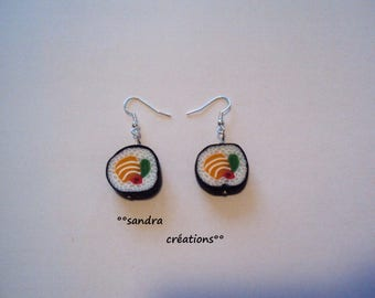 a pair of maki sushi earrings