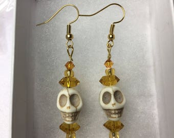 Skull earrings with yellow glass beads