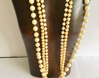 3 long strands of chanel style pearls