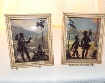 A Set of Two of Vintage Gold Framed Silhouette Man and Woman
