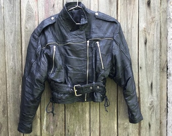 Nail Jacket/ Vintage/ genuine/ leather/ woman/ 90s/ black/ leather jacket/ lining/ size S-M/ pockets/ Adjustable belt/ Made in Italy