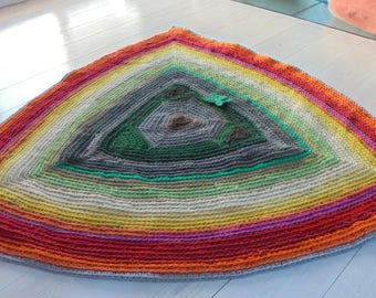 Three sides. Triangular rug made from recycled clothes