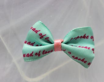 Pink bow tie blue writing