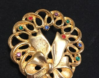 Vintage rhinestone wreath and bow brooch marked JJ