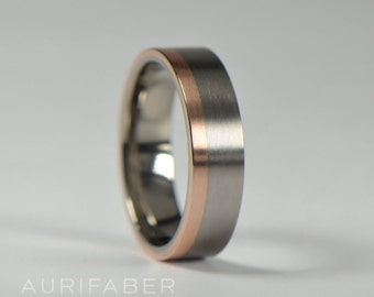 Flat titanium ring with red rosé gold stripe band. Matte titanium ring. Two tone design. Titanium gold ring. Nordic handmade from Finland.