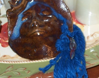 Two Pottery Masks with Yarn  Brown Ceramic Blue Highlights Hand Sculpted Wall Hanging Yard Art
