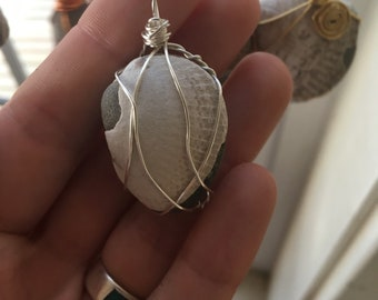 Wired-wrapped fossil pendant in silver