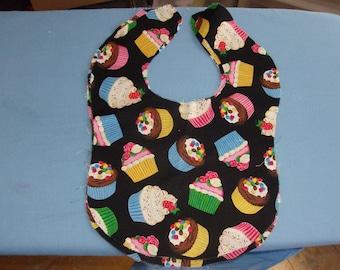 Baby bib toddler size Cupcakes on black cotton