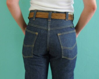 70's high waist boot cut jeans // sanforized dark denim jeans / dead stock ~ size 27 / 30